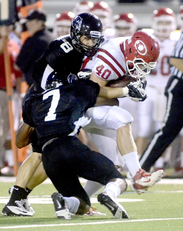 Ridgeland's Dillon Peterman and Vonn Bell bring down Dalton's Robert Hardaway Friday at Ridgeland High School.