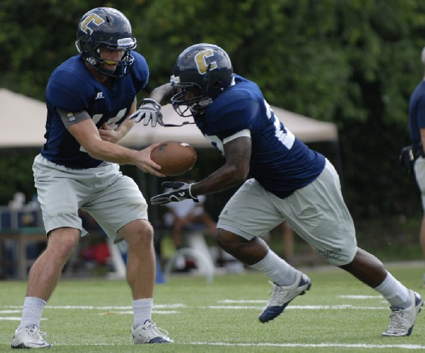 UTC starting quarterback Jacob Huesman hands the ball to running back Kenny Huitt during a recent practice at Scrappy Moore Field.