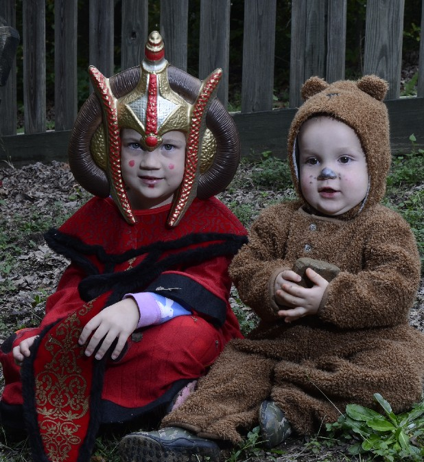 "Finley Burnette, dressed as Queen Amidala from ""Star Wars,"" and brother Forbes Burnette, dressed as a baby bear, model their Halloween costumes."