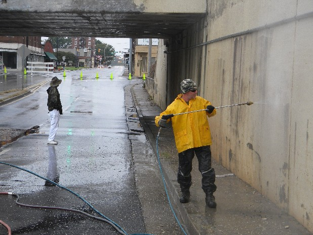 Inman Street at the railroad underpass in Cleveland will be closed all week. Lee Blankenship, with power washer, and Jeff Creasman of Hume's Painting, began taking away decades of grim Monday to prepare the underpass for new paint. Motorists can use the truck detour route around the low underpass, 8 a.m. to 4 p.m. through Friday.
