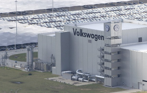 New Volkswagen Passats are seen behind the Chattanooga assembly plant's building.