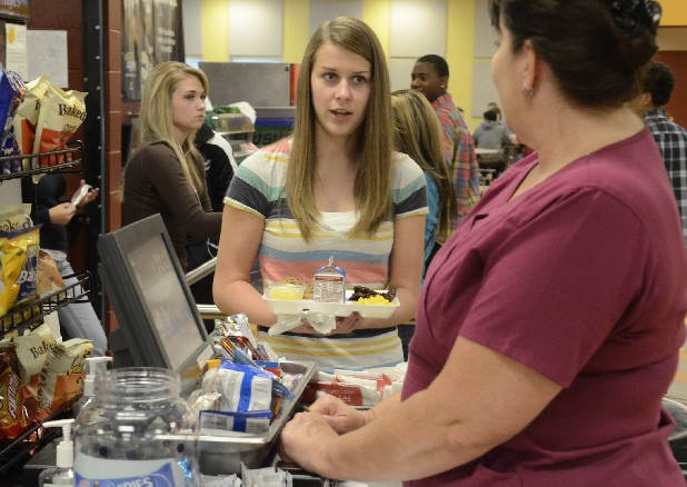 Twelfth-grader Paige Clark talks with cashier Gina Sachse during lunch at East Hamilton Middle High School.