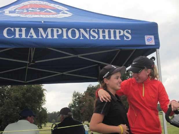 Signal Mountain freshman golfer Bethany Burns, right, hugs senior Haley Davidson. The Lady Eagles won their fourth straight state championship.