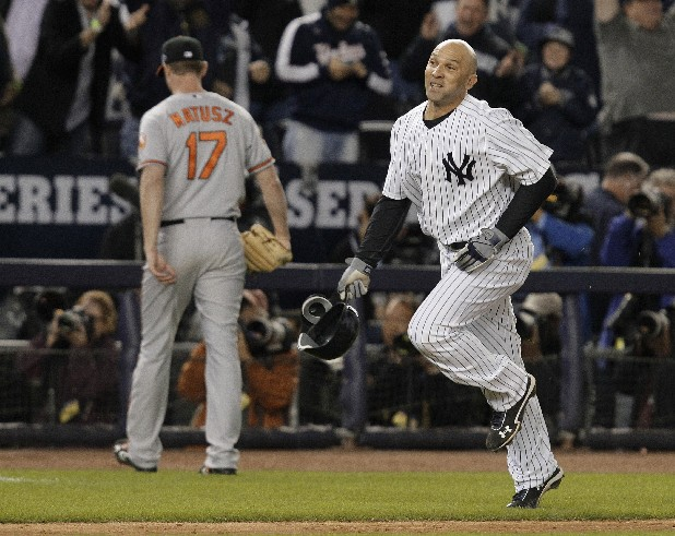 New York Yankees' Raul Ibanez (27) runs past Baltimore Orioles pitcher Brian Matusz after hitting the game-winning home run during the 12th inning of Game 3 of the American League division baseball series Wednesday, Oct. 10, 2012, in New York. The Yankees won 3-2.