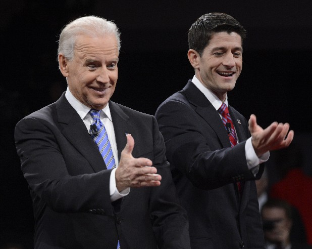 Vice President Joe Biden and Republican vice presidential nominee Rep. Paul Ryan of Wisconsin gesture after the vice presidential debate at Centre College, Thursday, Oct. 11, 2012, in Danville, Ky.