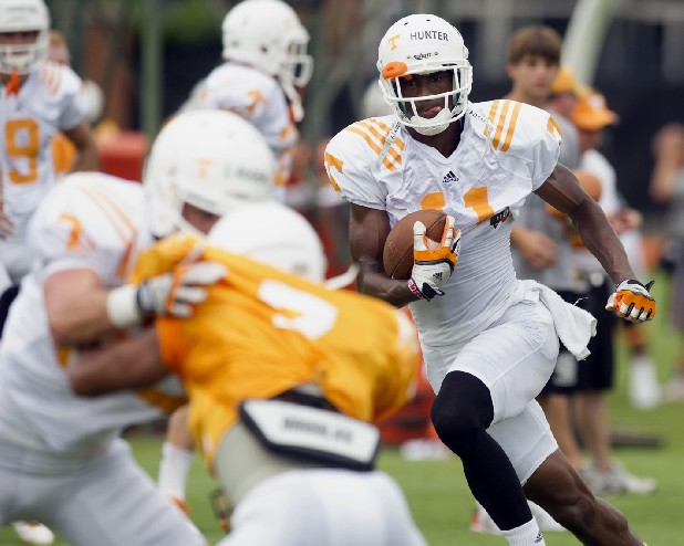 Tennessee wide receiver Justin Hunter looks for running room during practice.
