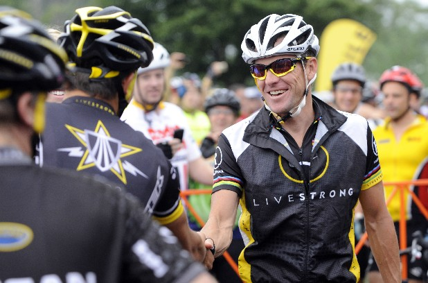 FILE - In this Aug. 22, 2010, file photo, cyclist Lance Armstrong greets fellow riders prior to the start of his Livestrong Challenge 10K ride for cancer in Blue Bell, Pa. Armstrong said Wednesday, Oct. 17, 2012, he is stepping down as chairman of his Livestrong cancer-fighting charity so the group can focus on its mission instead of its founder's problems. The move came a week after the U.S. Anti-Doping Agency released a massive report detailing allegations of widespread doping by Armstrong and his teams when he won the Tour de France seven consecutive times from 1999 to 2005. (AP Photo/Bradley C Bower, File)