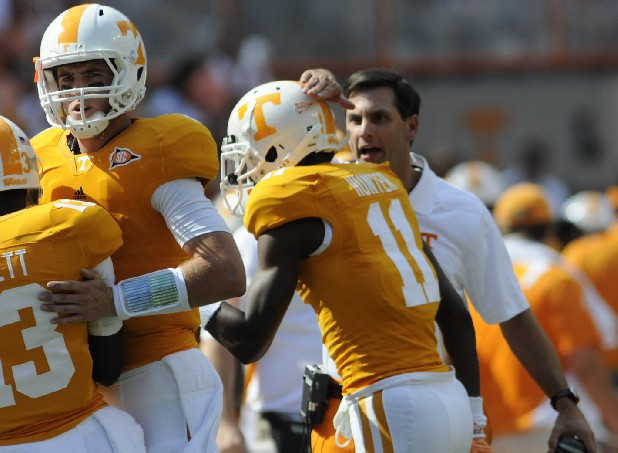 Coach Derek Dooley, right, congratulates Justin Hunter (11) after a touchdown.