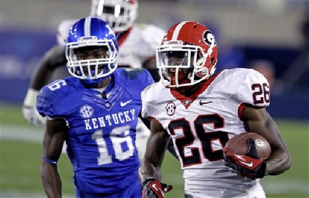 Kentucky defensive back Cody Quinn (16) could not catch Georgia's Malcolm Mitchell (26) on this second half run in their NCAA college football game in Lexington, Ky., Saturday, Oct. 20, 2012. Mitchell rushed for 103 yards on nine carries as Georgia came back to defeat Kentucky 29-24.