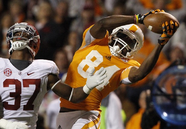 Tennessee wide receiver Cordarrelle Patterson (84) catches a pass over Alabama defensive back Robert Lester on Oct. 20, 2012, in Knoxville, Tenn.