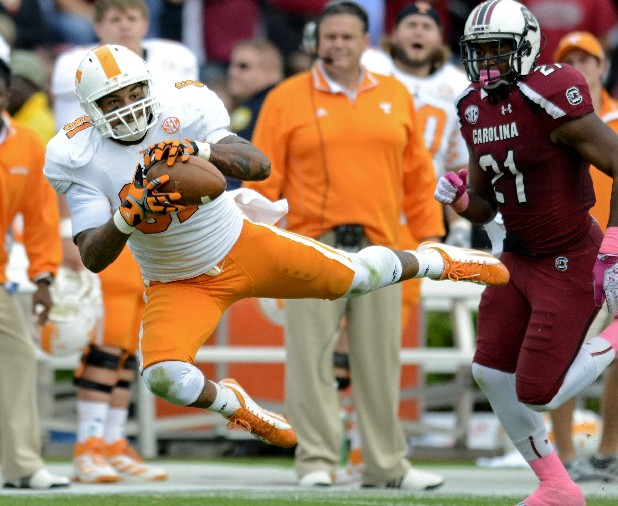 Tennesse tight end Mychal Rivera catches a pass in front of South Carolina's DeVonte Holloman during the first half of Saturday's game at Williams-Brice Stadium in Columbia, S.C.