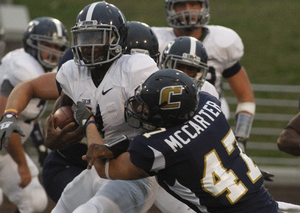 Georgia Southern's Jerick McKinnon is slowed in his advance by the Mocs' Zach McCarter during Saturday's game at Finley Stadium.