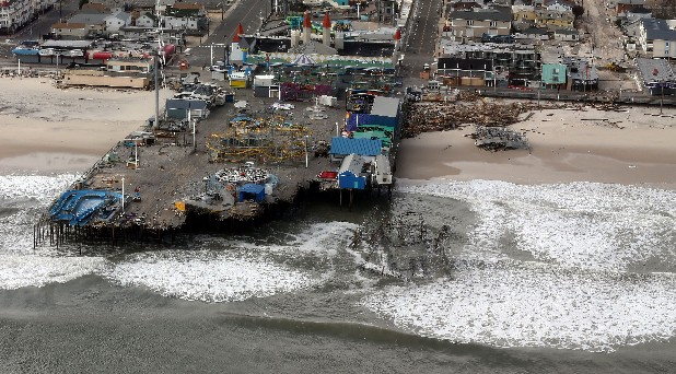 The view of storm damage over the Atlantic Coast in Seaside Heights, N.J., Wednesday, Oct. 31, 2012, from a helicopter traveling behind the helicopter carrying President Obama and New Jersey Gov. Chris Christie, as they viewed storm damage from superstorm Sandy.