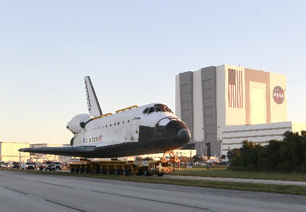 Space shuttle Atlantis make its way from the Vehicle Assembly Building to the Visitor Complex at the Kennedy Space Center early Friday in Cape Canaveral, Fla. Atlantis began its slow journey to retirement Friday, riding atop 76-wheeled platform on the 10-mile trek to the Kennedy Space Center's main tourist stop.