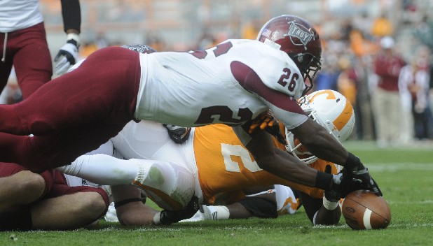 "Alton ""Pig"" Howard of Tennessese and Troy's Bryan Willis reach for the ball after Howard lost control of the ball. Willis recovered the ball and the play was first not called a fumble, but the ruling was overturned and Troy received the ball first and ten."
