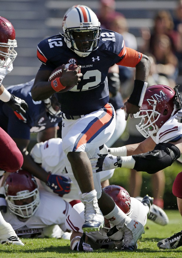 Freshman quarterback Jonathan Wallace made his first start for Auburn on Saturday and led the Tigers to a 42-7 win over New Mexico State.