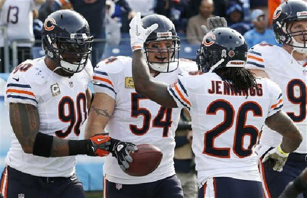 Chicago Bears middle linebacker Brian Urlacher (54) celebrates with Julius Peppers (90) and Tim Jennings (26) after Urlacher returned an interception for a touchdown against the Tennessee Titans in the first quarter of an NFL football game on Sunday, Nov. 4, 2012, in Nashville.