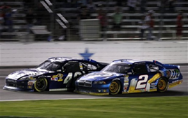 Jimmie Johnson (48) and Brad Keselowski (2) bump on the front stretch late in a NASCAR Sprint Cup Series auto race at Texas Motor Speedway, Sunday, Nov. 4, 2012, in Fort Worth, Texas. Johnson won the race.