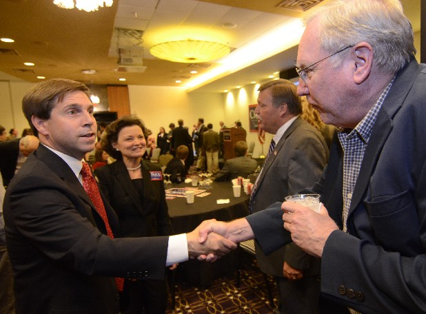 U.S. Rep. Chuck Fleischmann, left, greets Matt Cannon, right, as Connie Weathers, second from left, and Hamilton County Mayor Jim Coppinger talk Tuesday at the Doubletree Hotel. Fleischmann defeated Dr. Mary Headrick in the 3rd Congressional District race.