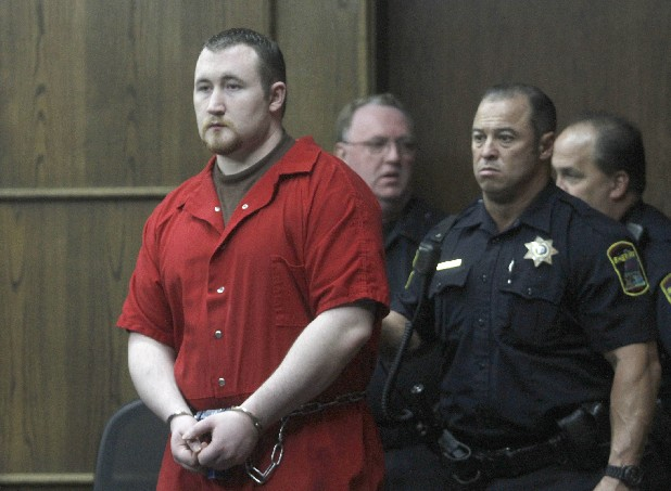 Jesse Mathews is escorted into court.