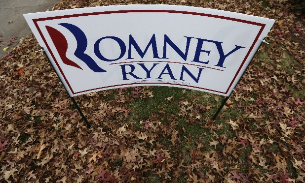 A campaign sign for the Republican presidential ticket sits outside Mitt Romney's campaign office in Manchester, N.H.
