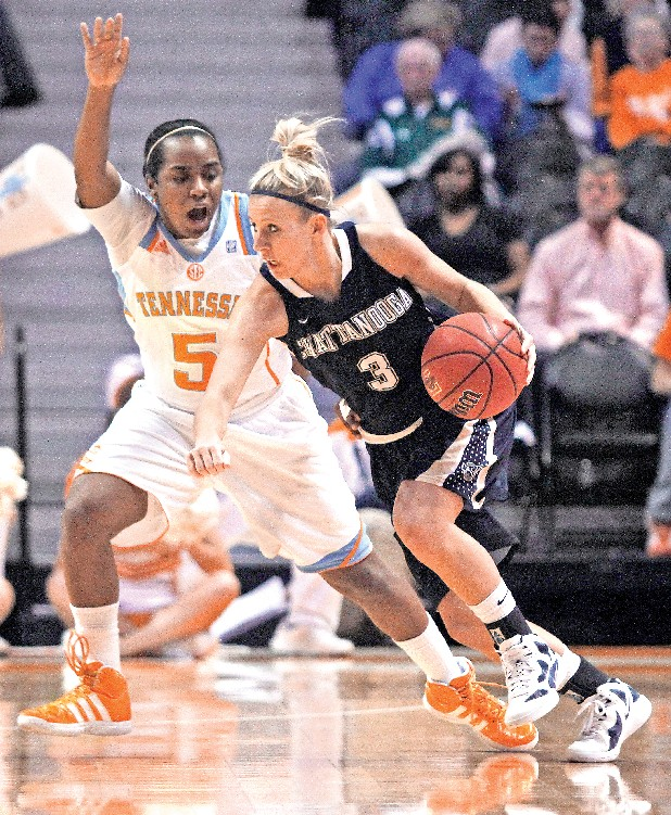 UTC's Kayla Christopher (3) drives against Tennessee guard Ariel Massengale (5) in the first half of an NCAA college basketball last year in Knoxville.