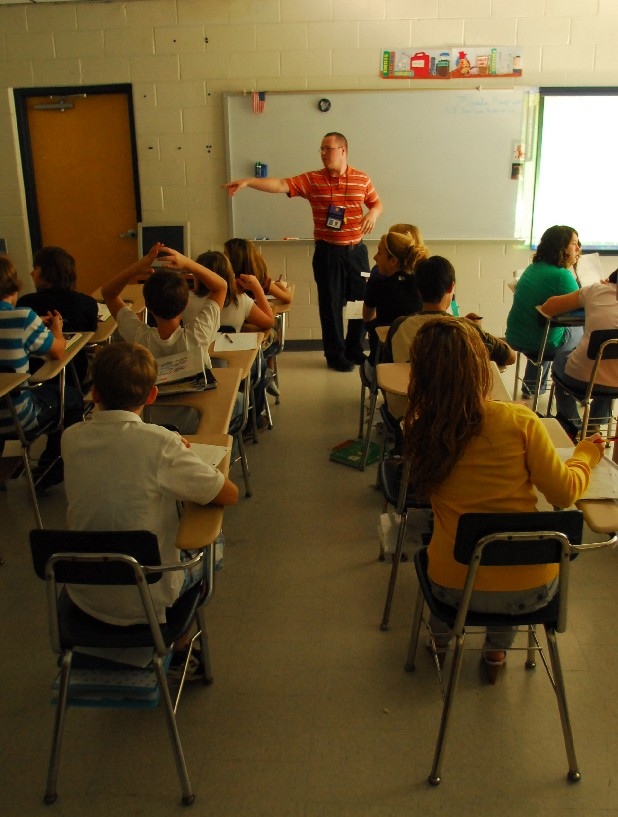 Seventh-graders at Sequatchie County Middle School listen to teacher James Cook in this file photo. Slower enrollment growth has county education leaders rethinking plans to build a new school.