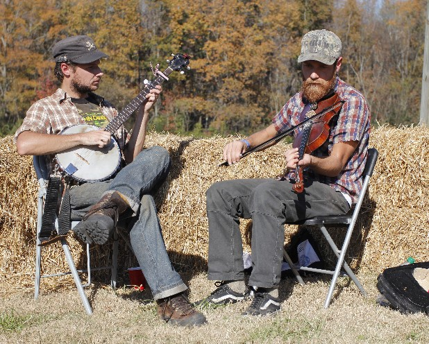 Chris Conn, left, and Mike Lester play bluegrass music for visitors.