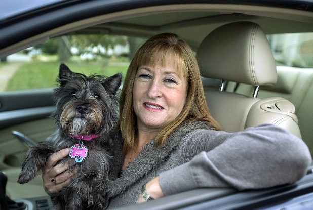 "Diane Spitaliere and her pet dog Izzie sit in her car outside her house in Alexandria, Va. Women have passed men on the nationís roads. More women now have driverís licenses than men, a reversal of a longtime gender gap behind the wheel that transportation researchers say is likely to have significant safety and economic implications. Spitaliere, 58, a retired government worker  says:  ""I want to be in my own car for as long as possible. I want to be independent for as long as I can."""