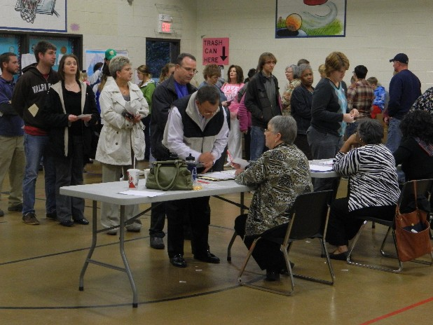 Residents register before casting ballots at the E.L. Ross Elementary School precinct in Cleveland, Tenn.