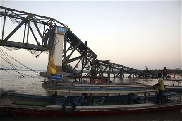A boat near the bridge damaged by a strong earthquake, in Kyaukmyaung township, Shwebo, Sagaing Division, northwest of Mandalay, Myanmar., Sunday, Nov. 11, 2012