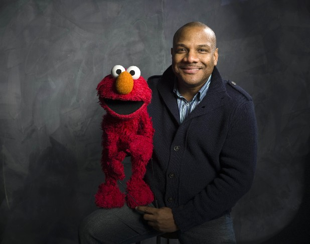"Elmo puppeteer Kevin Clash poses with the ""Sesame Street"" muppet . The man who accused Clash of having sex with him when he was a teen now says it isn't so. The man said in a statement released on Tuesday that his sexual relationship with Clash was adult and consensual."
