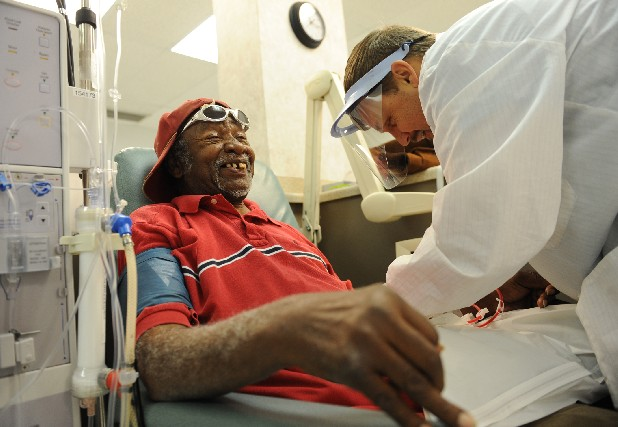 Albert Simmons jokes with patient care technician Chris Elrod, right, as he starts his dialysis treatment at Dialysis Clinic Inc. Simmons, who has been on dialysis for 30 years, says he enjoys interacting with the staff and patients during his visits to the clinic.