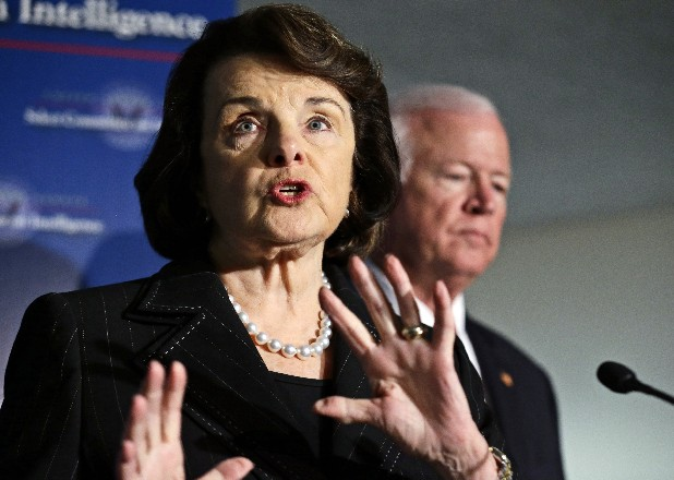 Senate Intelligence Committee Chairwoman Sen. Dianne Feinstein, D-Calif., left, with Senate Intelligence Committee Vice Chairman Sen. Saxby Chambliss, R-Ga., right, speaks during a media availability after a closed-door oversight hearing of the committee on Capitol Hill in Washington looking into the circumstances surrounding the deadly attack on the U.S. Consulate in Benghazi, Libya.
