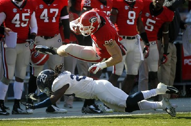 Georgia tight end Arthur Lynch (88) is brought down by Georgia Southern safety Deion Stanley (29) after a catch for first down in the first half of an NCAA college football game on Saturday, Nov. 17, 2012 in Athens, Ga.