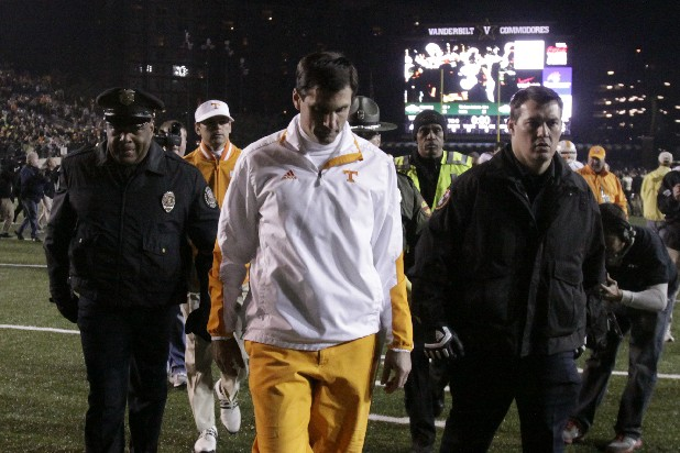 Tennessee coach Derek Dooley walks off the field after his team's loss to Vanderbilt.