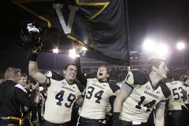 Vanderbilt players Josh Gregory, Andrew East, and John Townsley celebrate after winning 41-18 over Tennessee Saturday in Nashville.