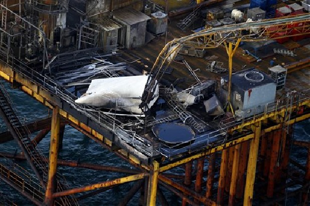 This aerial photograph shows damage from an explosion and fire on an oil rig in the Gulf of Mexico, about 25 miles southeast of Grand Isle, La., Friday, Nov. 16, 2012. Four people were transported to a hospital with critical burns and two were missing.