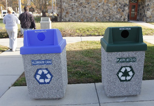 Travelers walk past two new recycling bins located by the vending machine station at the Interstate 75 Welcome Center in East Ridge.