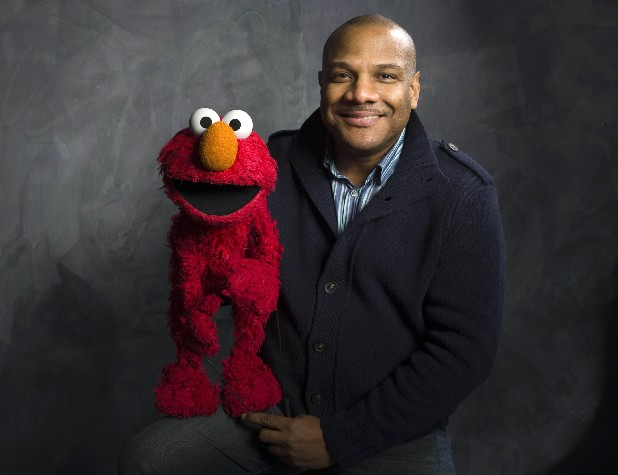 "In this Jan. 24, 2011 file photo, Elmo puppeteer Kevin Clash poses with the ""Sesame Street"" muppet in the Fender Music Lodge during the 2011 Sundance Film Festival in Park City, Utah. Sesame Workshop says Elmo puppeteer Kevin Clash has resigned from ""Sesame Street"" in the wake of allegations that he had sex with an under-aged youth. Last week a man accused Clash of having sex with him when he was a teenage boy, a charge Clash denied. A day later, the man recanted his charge. A lawsuit by a second accuser was filed Tuesday, Nov. 20, according to attorney Cecil Singleton. (AP Photo/Victoria Will, File)"