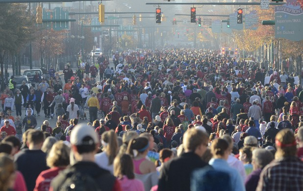 Thousands of people fill Market Street in downtown Chattanooga on Thursday morning during the Grateful Gobbler Walk, an event that benefits the Chattanooga Homeless Coalition.