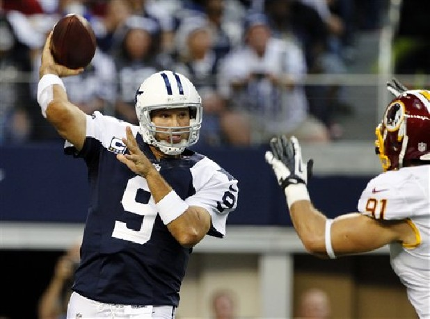 Dallas Cowboys quarterback Tony Romo (9) passes under pressure from Washington Redskins outside linebacker Ryan Kerrigan (91) in the first half of an NFL football game, Thursday, Nov. 22, 2012 in Arlington, Texas.