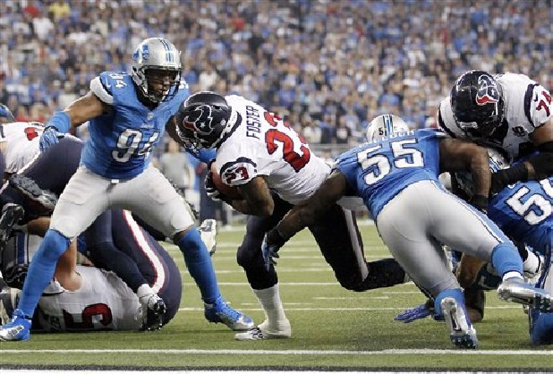 Houston Texans running back Arian Foster breaks away from Detroit Lions defensive end Lawrence Jackson (94) and linebacker Stephen Tulloch (55) for a touchdown during the fourth quarter of an NFL football game at Ford Field in Detroit, Thursday, Nov. 22, 2012.