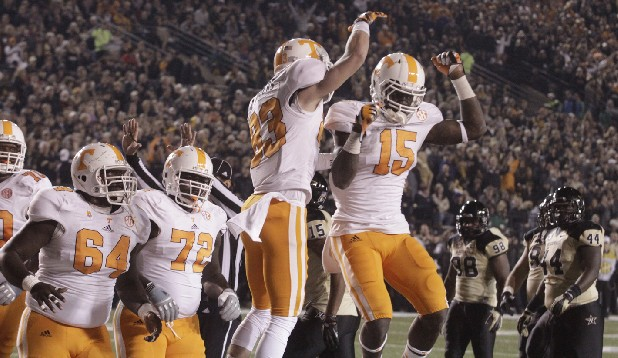 Tennessee tailback Marlin Lane celebrates with wide receiver Zach Rogers after Rogers scored a touchdown against Vanderbilt on Saturday in Nashville.