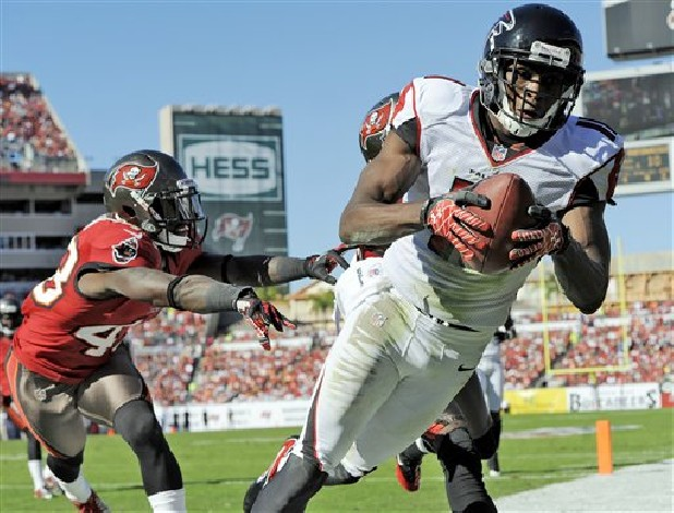 Atlanta Falcons wide receiver Julio Jones (11) is shoved out of bounds by Tampa Bay Buccaneers free safety Ahmad Black (43) during the second quarter of an NFL football game Sunday in Tampa, Fla. Jones was ruled out of bounds.