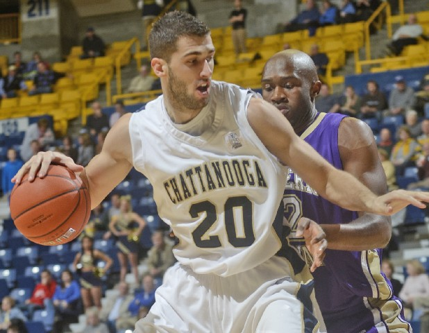 Drazen Zlovaric of UTC is guarded by Western Carolina's Tawaski King during a January 2012 game at McKenzie Arena.