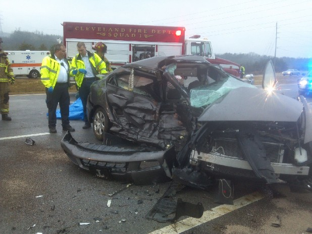 CRASH SCENE — Bradley County paramedics Eric Johnson left and Troy Thornton right, observe the aftermath of the accident on I-75. Contributed photo/Bradley County EMS