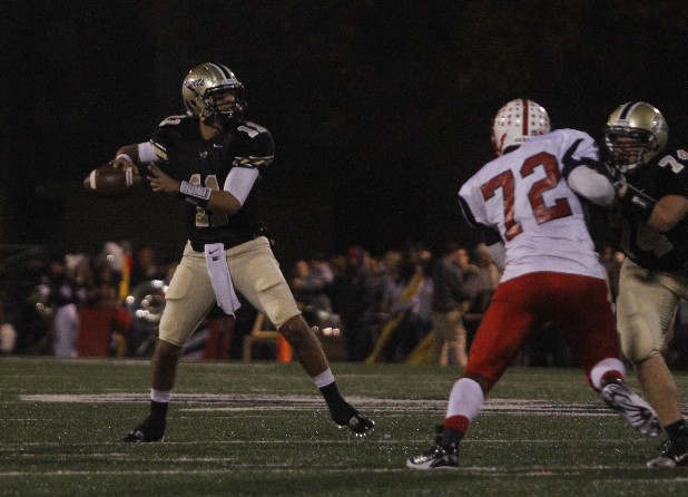 Calhoun quarterback Taylor Lamb, No. 11, looks for a receiver a game against Brooks County.