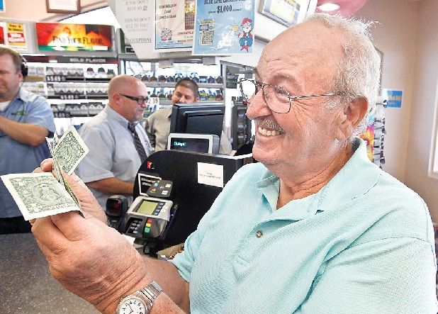 Wes Prinzen, of Fountain Hills, Ariz., smiles as he takes away his modest $4 winnings at a 4 Sons Food Store where one of the winning tickets in the $579.9 million Powerball jackpot was purchased.