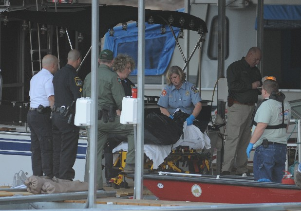 Emergency personnel work in the docks at Lakesite Marina where boaters discovered a body floating in the water.